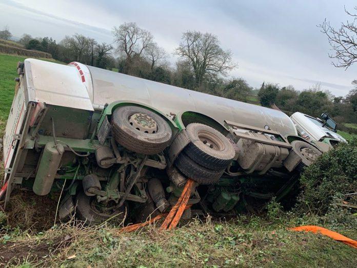 Milk tanker overturns