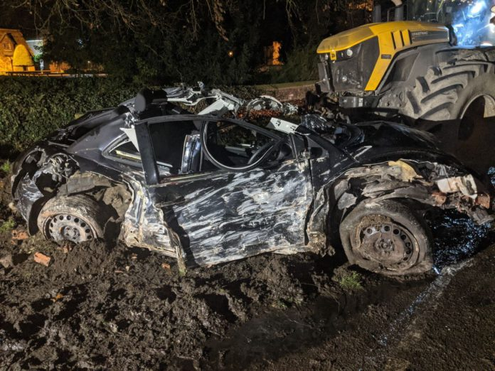 Car and tractor towing slurry spreader collide