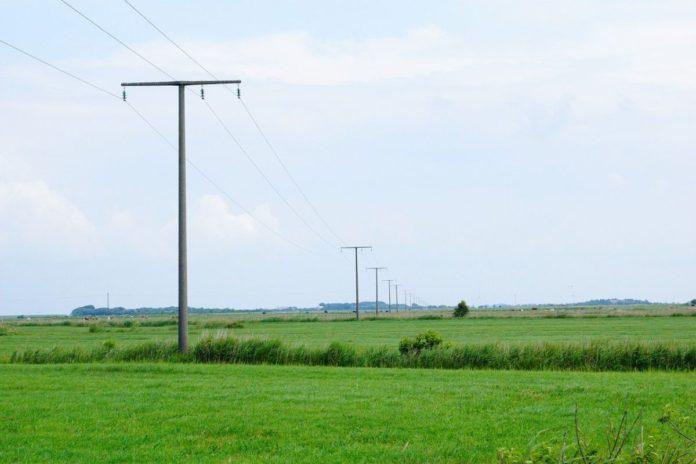 Electricity pole, field