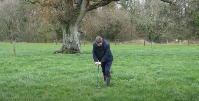 Taking soil samples, grassland,