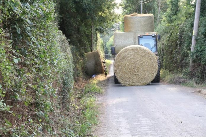 straw, tractor, machinery, accident, incident, straw bales, bales, road, roadway, agricultural news, farm updates