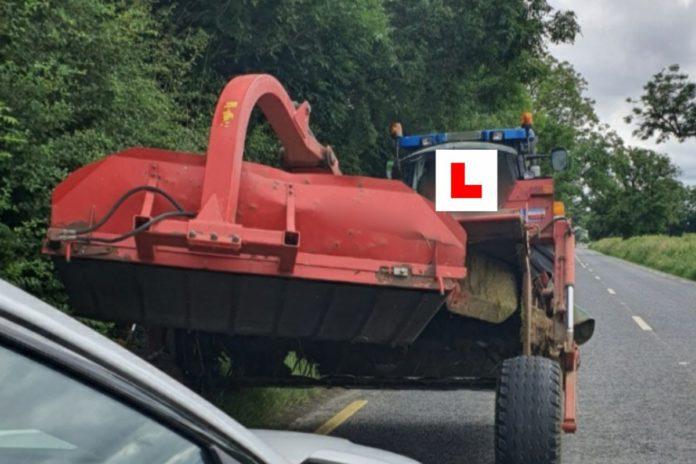 farming news, tractor driver on phone, farmers, tractors, An Garda Síochána