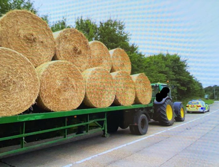 Road Safety tractor trailer and bales - farm safety