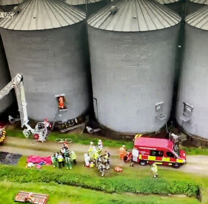 Emergency services have successfully saved a farmworker who fell down a 40ft silo. The three-hour operation, involving a team of rescuers, took place at Milton Ernest Farm in the UK.