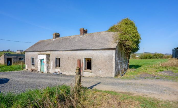"""Keenan Auctioneers is guiding circa 24-acres with an old single-storey cottage in Crosskeys, Co Cavan at €195,000. According to the property firm, the stone cottage will """"need work, but that will be effort well spent on this compact, sheltered, picturesque site""""."""